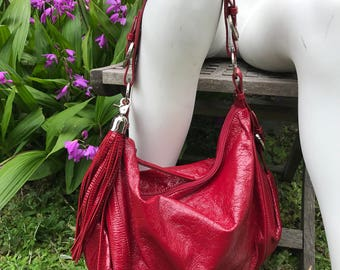 Red patent leather AGATHA handbag with tassel statement bag