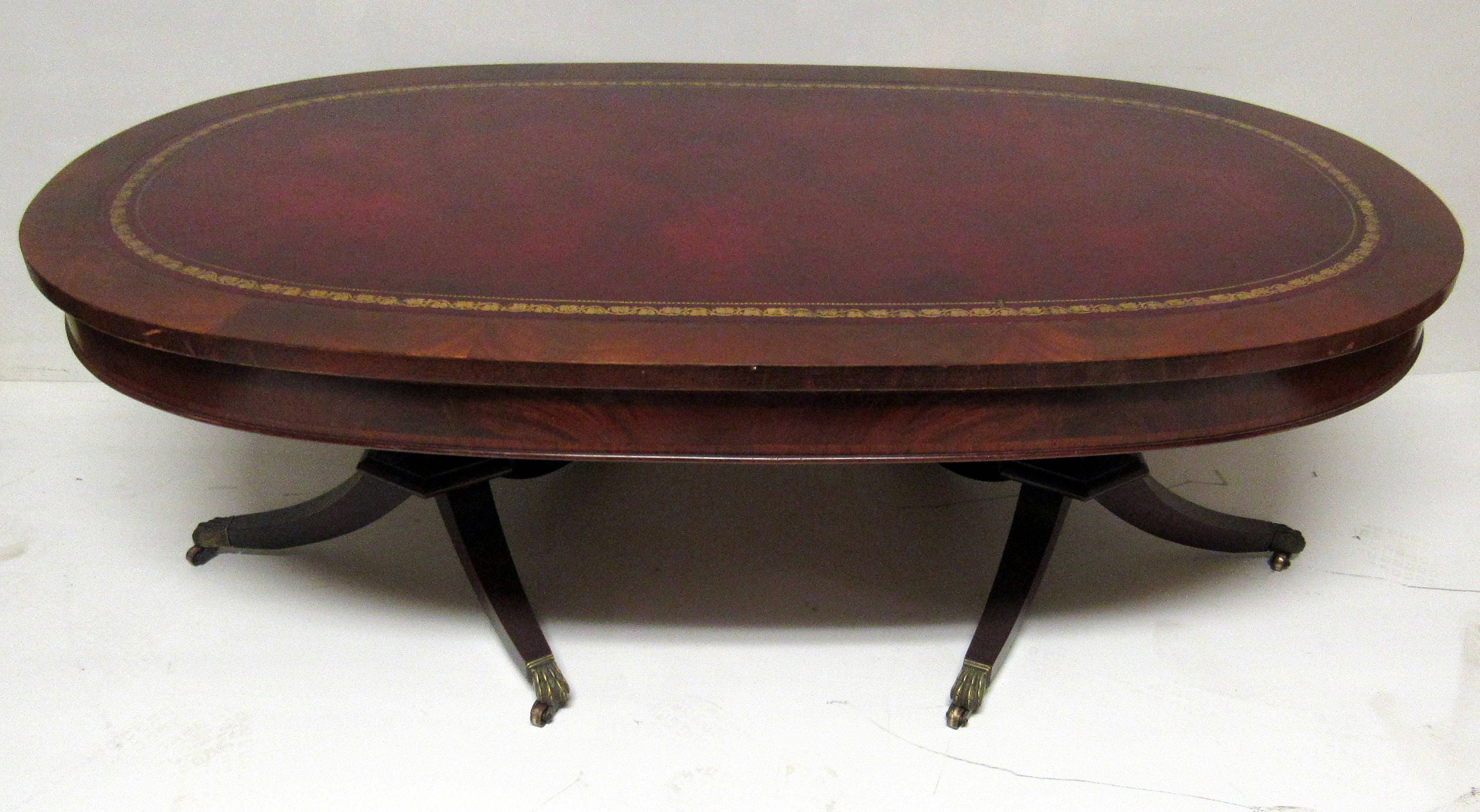 Flame mahogany coffee table oval shaped leather top Oval shaped coffee table