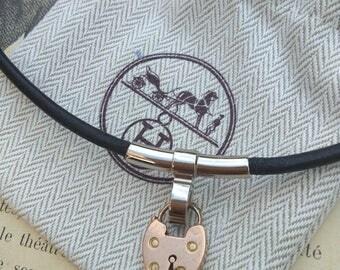 Original vintage HERMES FRANCE PARIS black leather and gold tone locket necklace engraved Hermes antique pink gold vermeil Heart locket