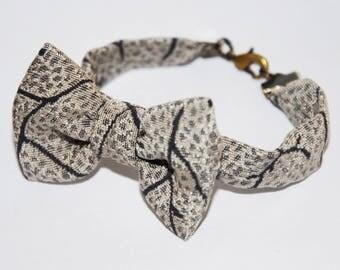 Bracelet 70 bow beige and grey jacquard