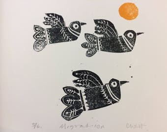 Migration hand made hand printed limited edition lino print showing birds in flight.