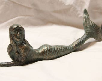 Cast iron mermaid novelty figurine.  All metal