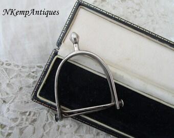Antique stirrup paper holder real silver