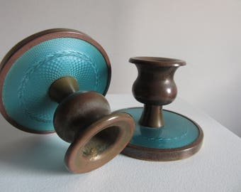 pair of faux guilloche and bronze candlesticks