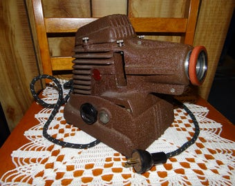 Vintage Slide Projector Purrs Like a Kitten