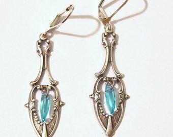 Earrings dangling art nouveau metal engraved silver with blue dagger bead