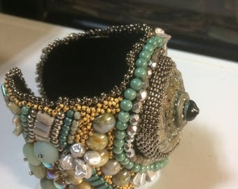 Bead embroidery Statement cuff, raku bead with teal and gold bead embroidery.