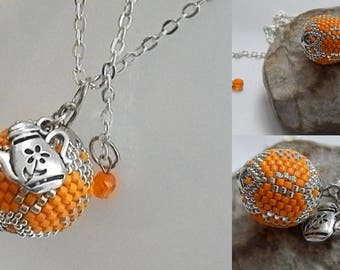 orange and silver beaded Ball pendant