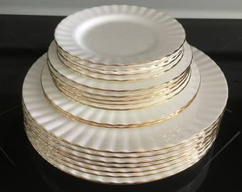 Royal Albert Val D'or Dinner plates Salad Plates Dessert Plates and Bread and Butter Plates.