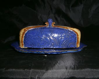 Bright blue butter dish.