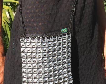 Pouch made of recycled cans capsules