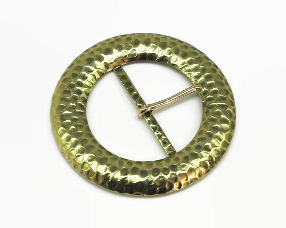 Large 1980's circular gold metal buckle with tongue and hammered metal finish, very decorative