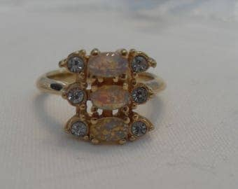 Vintage Faux Opal Gold Avon ring, Size 5 3/4, excellent vintage condition, 1/2 inch wide. Gingerslittlegems