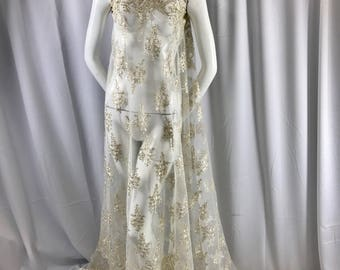 Ivory paisly flower enbroider and corded with metallic gold tread on a mesh lace-wedding-bridal-prom-nightgown-dresses-sold by the yard.