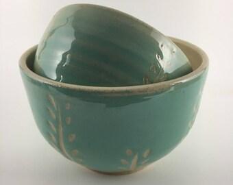Teal ceramic nesting bowls