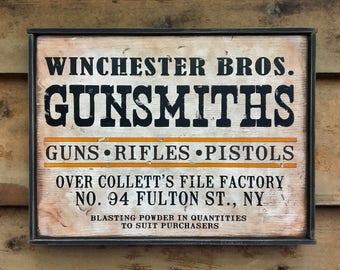Rustic wooden sign 'Gunsmiths'