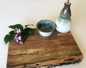 Hand crafted pecan cutting board with matching oil cruet and bowl set