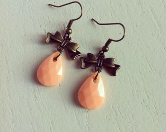bronze bow earrings and drop peach