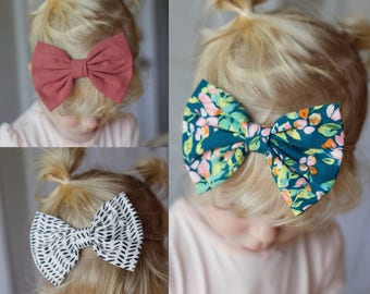 Okay, these are my favs: floppy bow set, baby nylon headbands, toddler bow, toddler clip