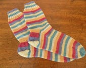 Bright fun colourful pattern matched self striping Ladies Medium, Gents Small sized hand knitted 4 ply socks. Heel flap construction