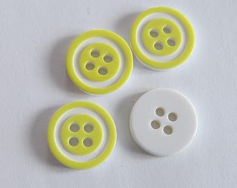 Pretty pale yellow and white button with circle front