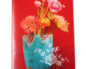 "Notebook fuchia ""Ranunculus Orange and blue vase on a red background"""