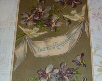 Clearance Sale Doves Carrying Banner With Heartiest Congratulations Surrounded by Purple Violets Antique Postcard