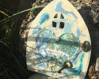 Fairy Doors ~ magical, handcrafted and Handpainted Fairy Doors available in different colours and adorned with a Fiddlestitched Heart.