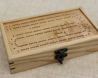 Continuous Track Cribbage Board with Card and Peg Storage and Double Six Domino Set