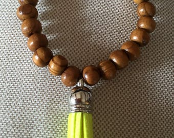 Elastic beaded bracelet handcrafted exotic wood with neon yellow tassel