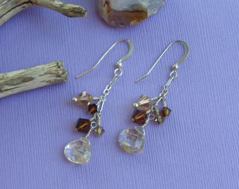 Rutilated quartz earrings. Neutral tone gemstones create a classic fashion style for this year.