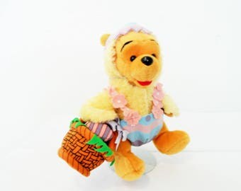 Easter Winnie The Pooh Dressed As A Chick Holding A Easter Basket With Eggs and Colorful Eggshell On His Head/New With Disneyland Tags.