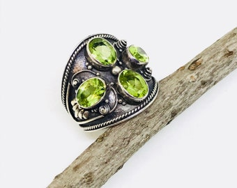 Peridot ring set in sterling silver 925. Natural authentic peridot stones. Size -7. August birthstone