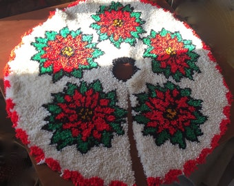 "Bucilla Christmas latch hook Tree Skirt Poinsettia completed 39"" across."