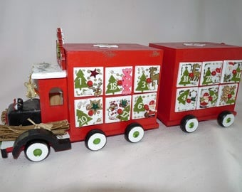 "ADVENT calendar ""decorated with wooden trailer truck"