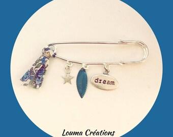 Silver charm and liberty metal pin