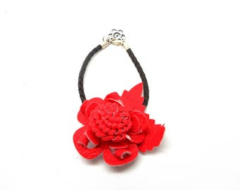 imitation leather and red flower bracelet