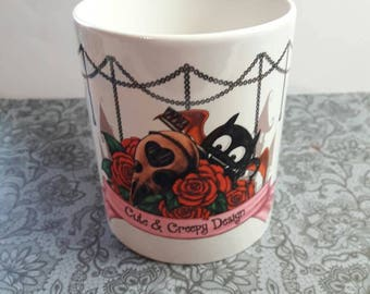 Cup with Vladi on a bird skull and roses.