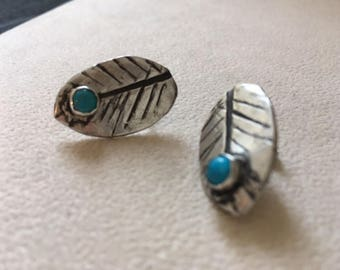 Sterling silver fat leaf dangle earring with turquoise stone.