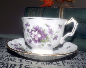 Vintage (c.1960s) Aynsley England Violette pattern tea set (footed cup w/matching saucer). Violets, white ground, gold edge, accents.