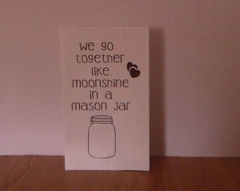 We go together like moonshine in a mason jar wood sign.