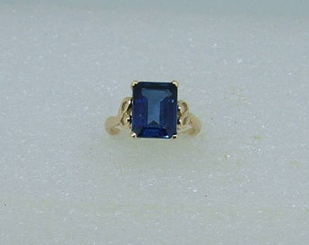 Gold and man made blue Sapphire ring.  9 carat yellow gold ring set with a blue synthetic Sapphire