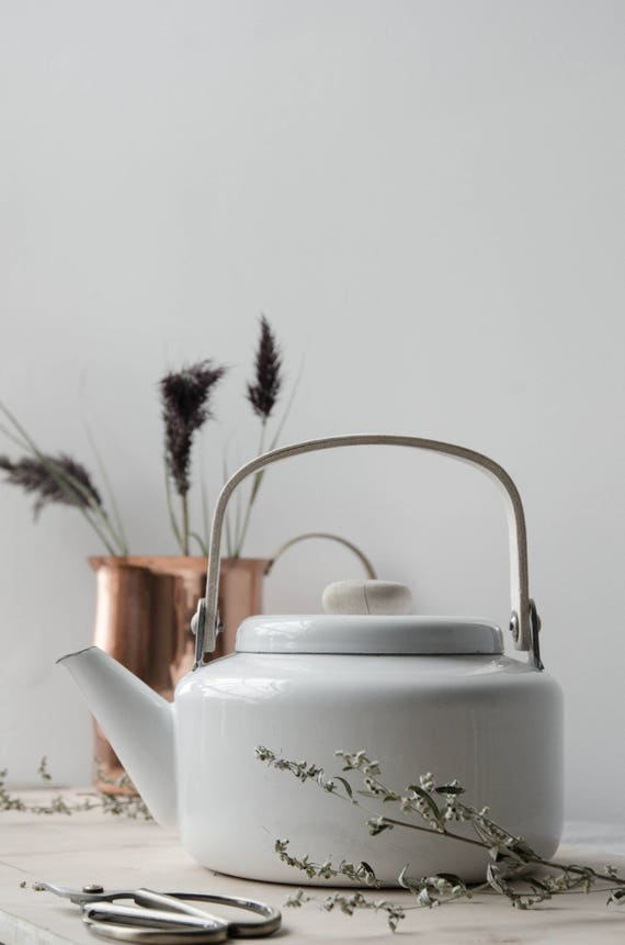 Vintage white enamel kettle with wooden handle