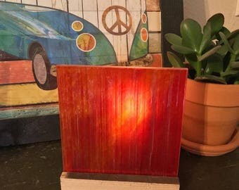Candle holder made with reclaimed Architectural materials