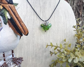 Leather necklace with a cluster of green beads