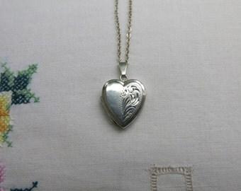 Silver half-engraved vintage heart locket
