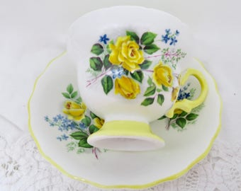 Rosina Yellow Roses Blue Flowers Pattern Bone China Footed Teacup and Saucer 1950's