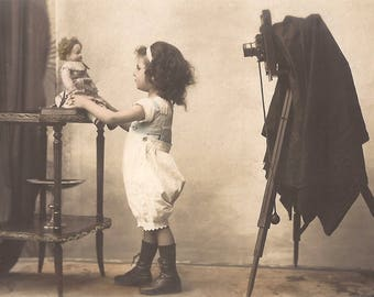 RARE CHILDREN PHOTOGRAPHER!!! 1900s Original Antique French Belle Epoque Photo Postcard…Victorian Little Girl Scene with Doll & Photo Camera