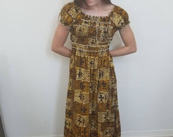 60's Brown Tiki Hawaiian Peasant Dress. Floral. Aloha Dress. Maxi dress. Smocked front. Size Small.