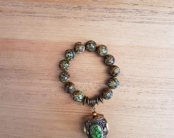 Woman-14, mottled agate bracelet.